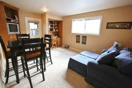 Family Room with game table, TV, comfy chairs, desk (Downstairs)