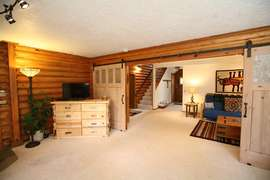 King Master - Downstairs - Spacious with barn doors and exterior access.