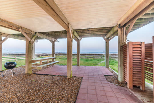 Underneath the home with beach access, picnic table and grilling area