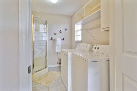 Master Bathroom with washer and dryer