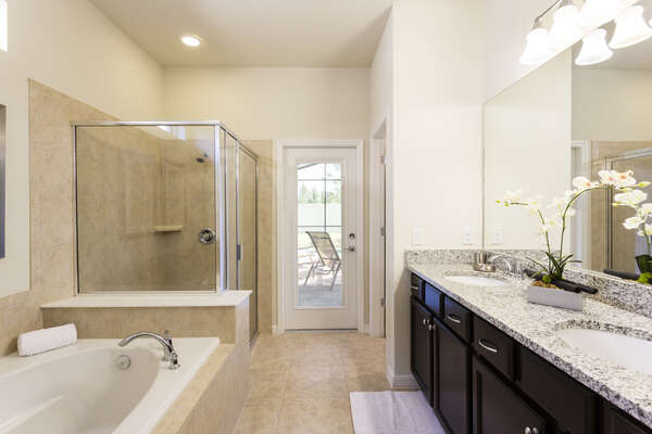 Spacious master en suite bathroom with private pool access