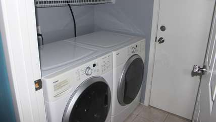 The laundry room has a full size front load washer and dryer. You'll find dryer sheets for your use...a nice touch!