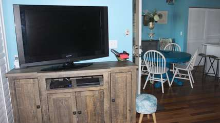 Watch shows on the large HDTV w/ BluRay player. Feel free to watch any of DVDs stored inside the media cabinet. There are several games and cards to keep you entertained with family fun as well.