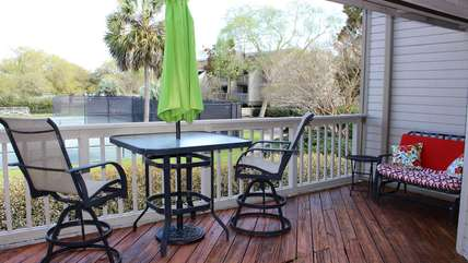 The deck has a bistro table overlooking the tennis courts. Across the courts enjoy the distant view of Palmetto Lake. This is a wonderful spot for your morning coffee or tea.
