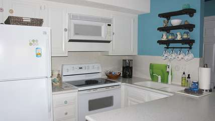 The kitchen features updated new appliances and has beautiful Corian counters.