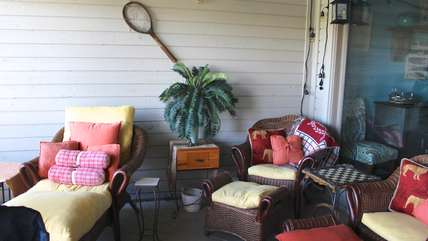 Gather on the screened porch and relax on the comfy chairs or fall asleep in the cozy chaise.