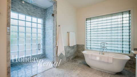 Master bathroom with walk in shower and relaxing bath tub