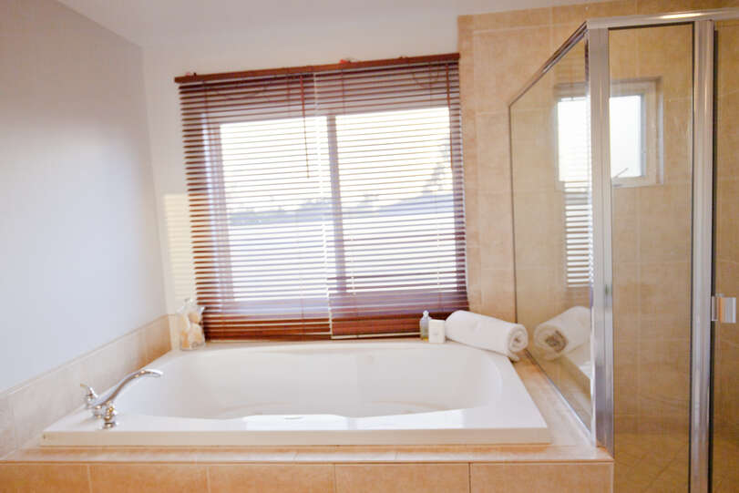 The master ensuite includes a Jacuzzi tub to relax at day's end