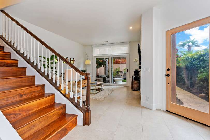 Staircase blends downstairs tile with gorgeous upstairs wood flooring