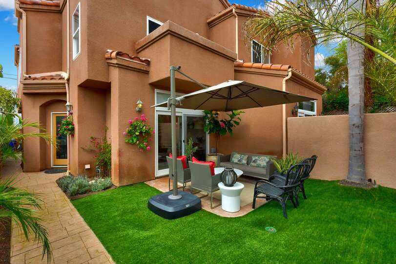 Charming three bedroom home with private lawn and patio