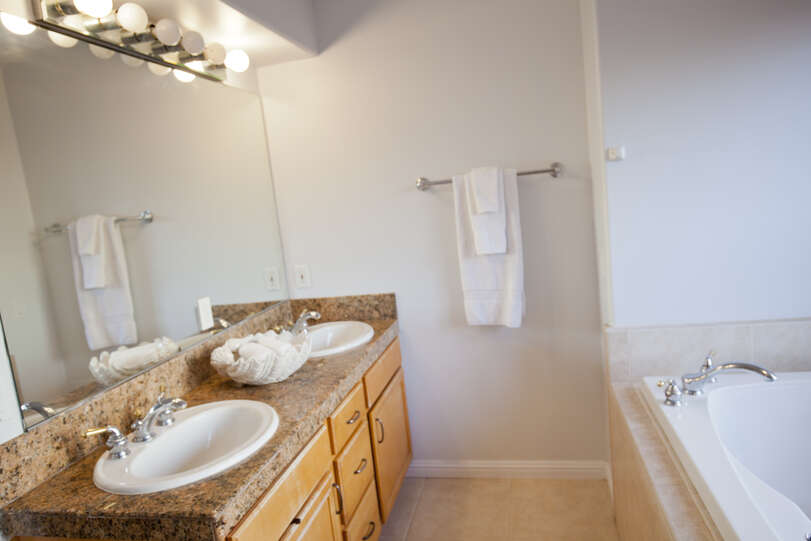 Large mirror and windows make the bathroom bright and inviting