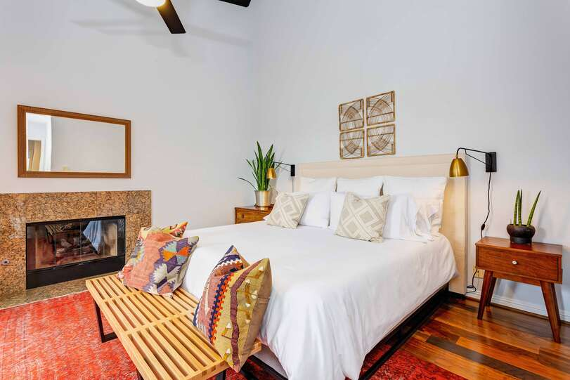 The master suite includes a fireplace for ambience