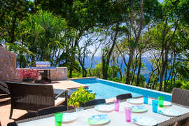 Outdoor dining area overlooking the Caribbean
