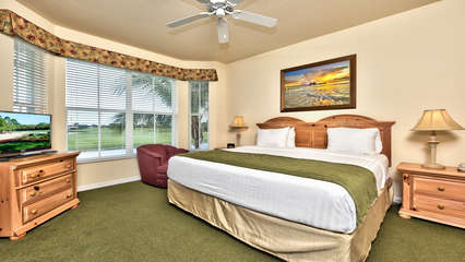 Master Bedroom with Flat Screen TV, Fan, and Lake and Golf Views; Private Entrance to the Lanai Area; Unrivaled Golf Resort Location!