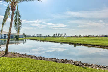 Backyard Of Condo With Lake And Golf Course View;