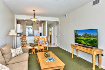 Living Room With HDTV;Entrance to Lanai Area with Golf and Lake Views;