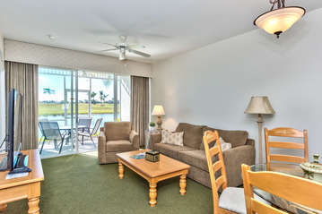 Living Room With HDTV; Private Lanai Area Overlooking Lake and Golf Course;