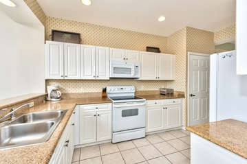 Fully Stocked Kitchen Area; Perfect For Home Cooked Meals!