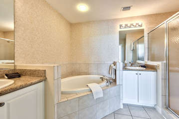 Master Bathroom with Double Vanity, Walk in Shower, and Spa Tub! Perfect Relaxing Tub After a Day in Sunny Naples!