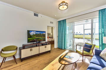 Living Room with Brand New Furniture and Flat Screen HDTV; Entrance to Lanai Area with Golf and Lake Views;