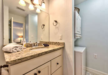 Bathroom with shower and laundry;