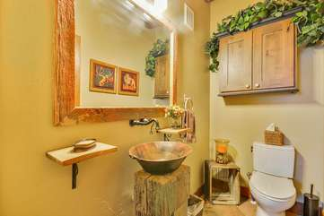 Half-Bath with an Authentic Copper Mining Pan for sink basin.