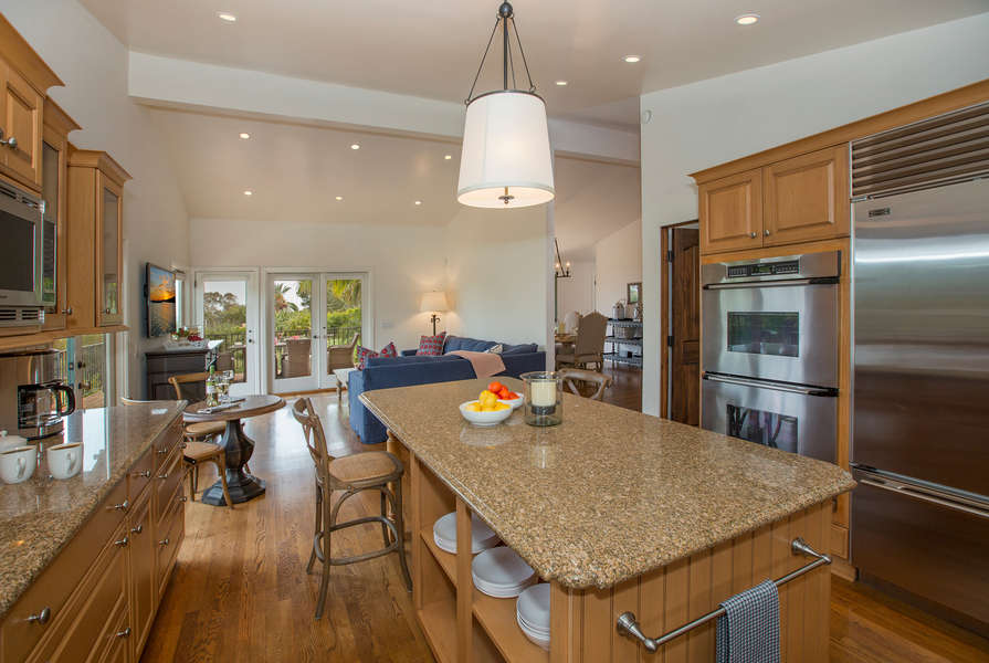 Open floor plan flows between Kitchen and Family Room