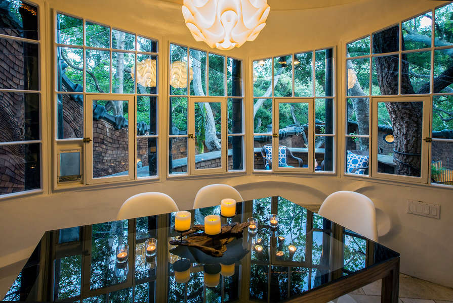 Dining Room overlooks pool and lush gardens below.