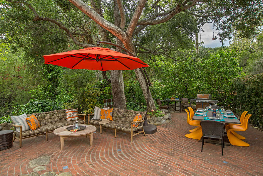 The front yard patio is a tranquil setting to enjoy the natural surroundings
