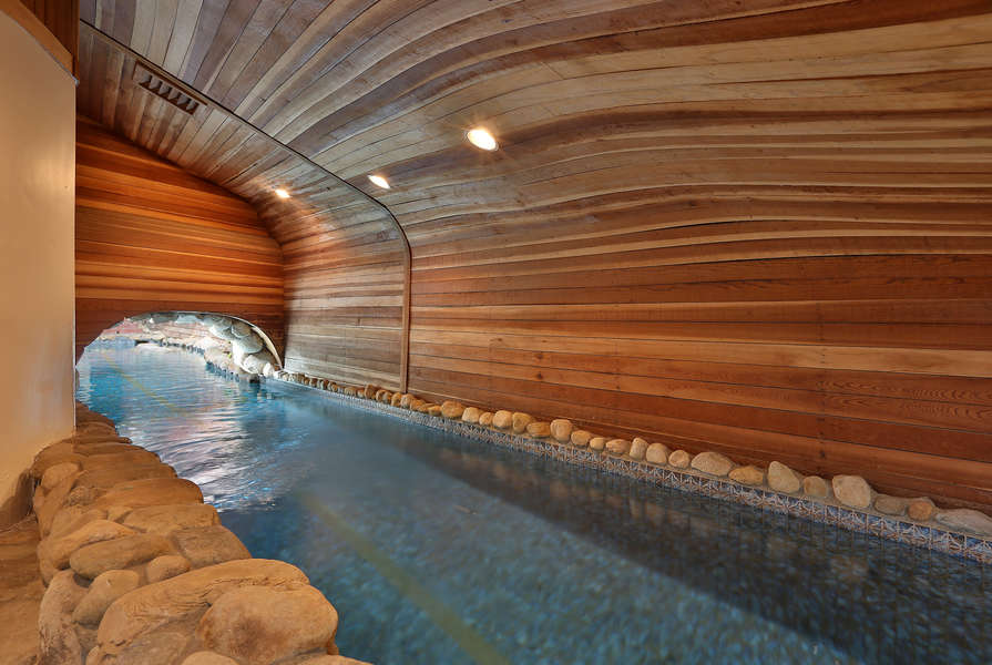 The lap pool flows into a room connected to the Guest House