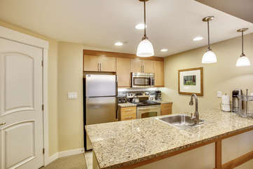 Full Kitchen with Granite Counter Tops and Stainless Steel Appliances