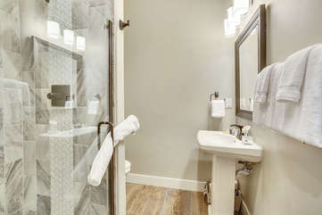 Beautiful full bathroom on main level with custom stone shower.