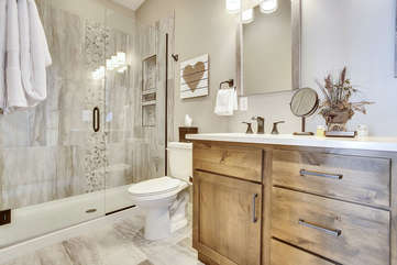 Fantastic custom master bathroom with a large stone shower.