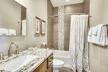 Great full size upper level bathroom with custom stone.
