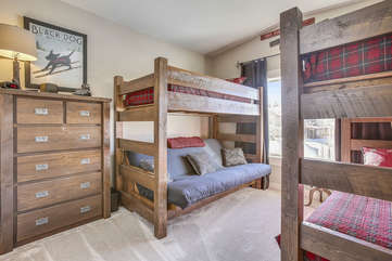 Large bunk room with custom beds and great views.