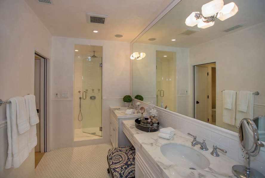 Master Bathroom with dual sinks and walk-in shower