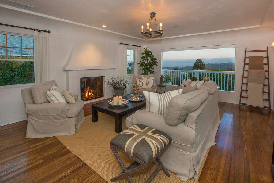 Living Room with fireplace and ocean views