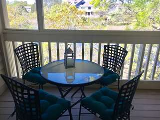 Sliding glass doors lead to the large screened in porch for eating or playing card after a day at the beach.