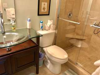 The master bath has been updated and has a glass sink & tile flooring.