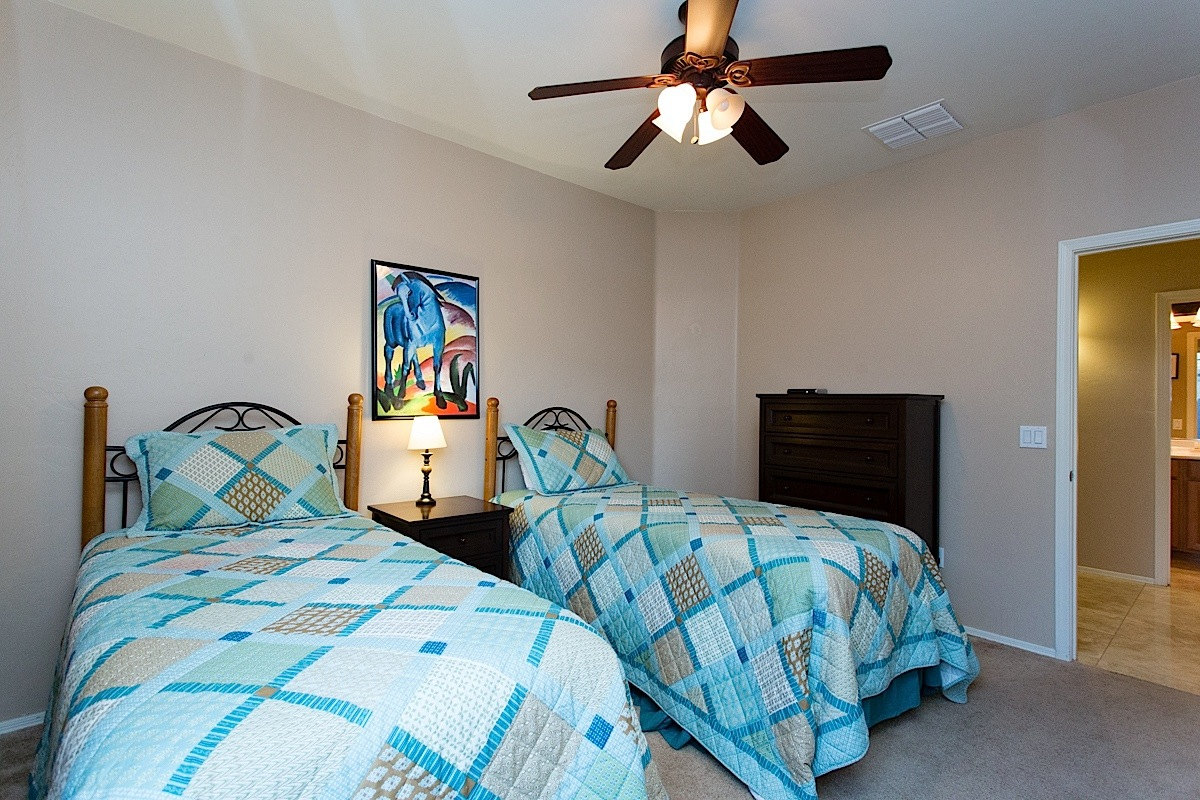 guest bed three with twin bed that can also be converted to a king