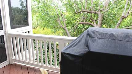 There is a gas grill on the deck off the living area.