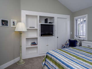 The room has built in shelves and an HDTV. There is an armoire for your clothing.