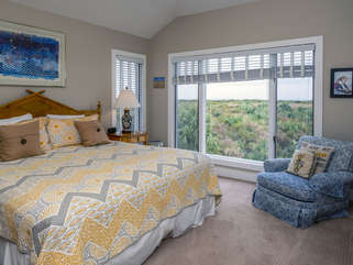 The master bedroom features spectacular views