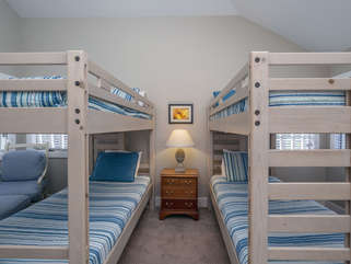The 3rd bedroom has two sets of twin bunk beds.