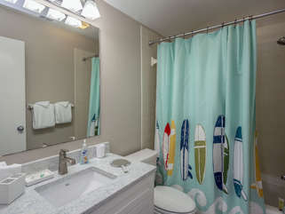 The attached bathroom has a shower/tub.