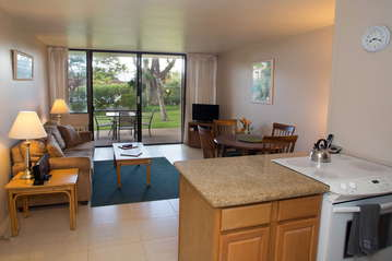 Kitchen view is open into living room and outside to lanai