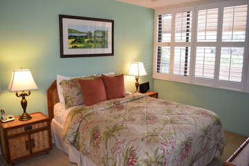 Bright master bedroom with tropical decor