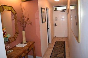 Entryway to front door and bedroom
