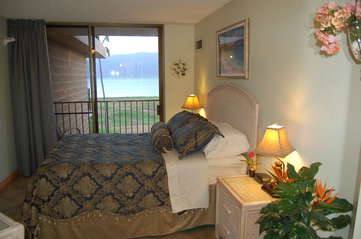 Master bedroom with ocean views and private lanai entrance
