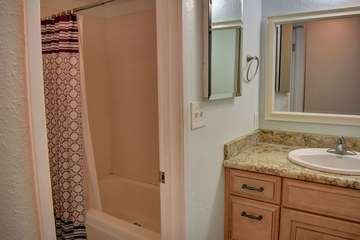 Shower tub combo in bathroom and updated vanity